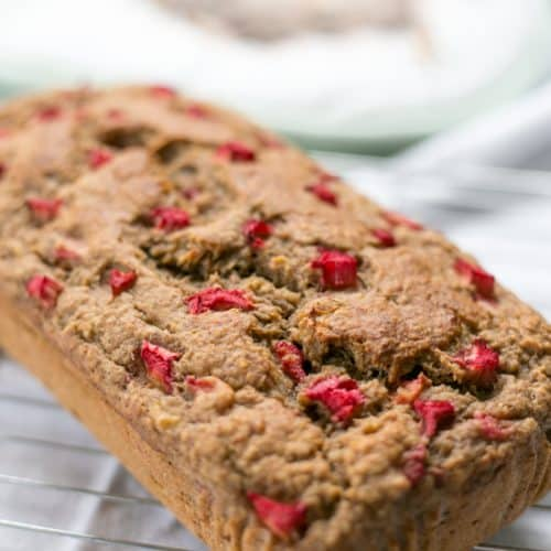 A loaf of Healthy Sugar Free Rhubarb Banana Bread | BakeThenEat.com