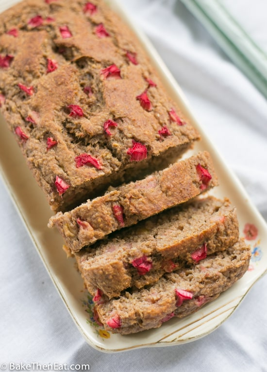 A sliced up loaf of Healthy Sugar Free Rhubarb Banana Bread | BakeThenEat.com