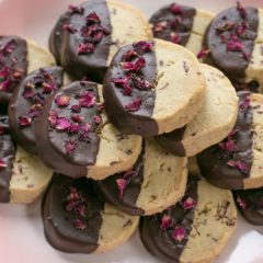 A plateful of Dark Chocolate Dipped Rose Shortbread | BakeThenEat.com