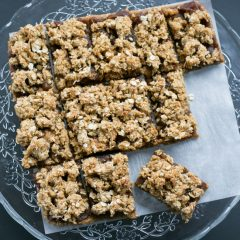 Easy Sticky date oat slices on a tray | BakeThenEat.com