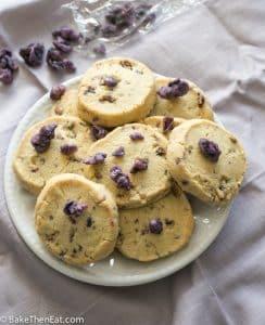 A plate of sweet floral crystallised Violet shortbread | BakeThenEat.com