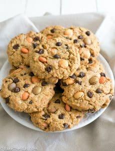 A big plate of Seasonal Coloured Autumn Monster Cookies | BakeThenEat.com