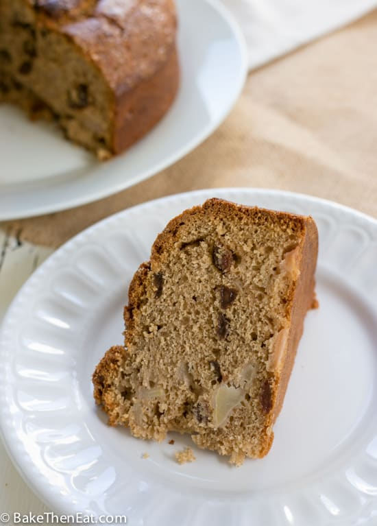 A slice of Lightly Spiced Sultana Pear Cake | BakeThenEat.com