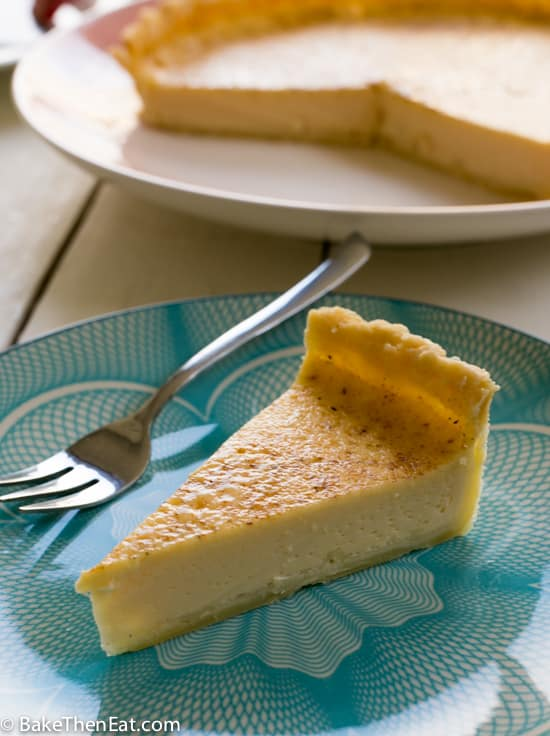 A slice of this Super Simple Old Fashioned Egg Custard Tart | BakeThenEat.com