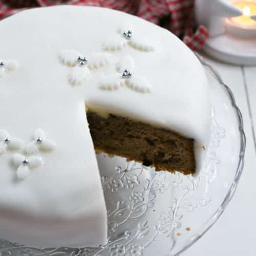 Quick and Easy Fake Christmas Cake with a slice cut out of it | BakeThenEat.com