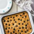 A big uncut tray of Cannellini Bean Blueberry Almond Tray-Bake | BakeThenEat.com