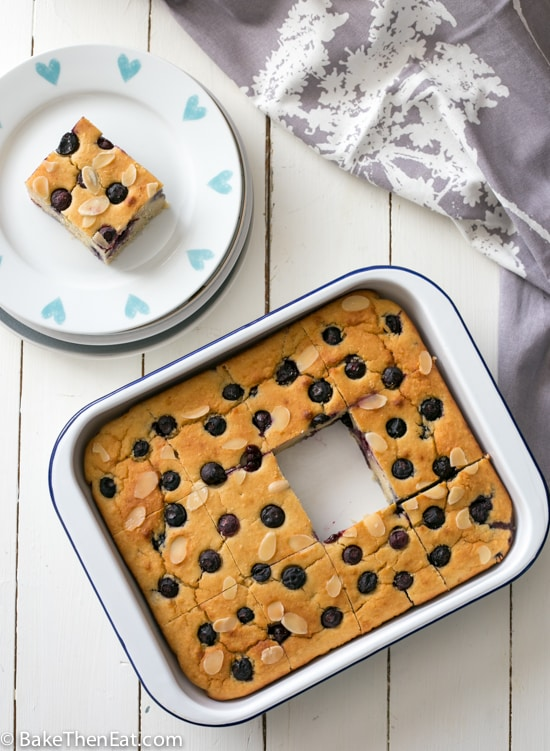 A slice of the Cannellini Bean Blueberry Almond Tray-Bake has been cut out and plated up | BakeThenEat.com