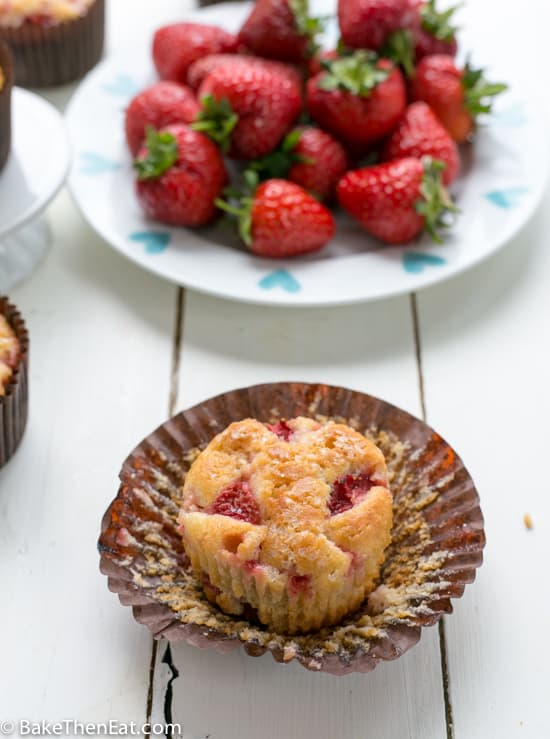 Low Sugar Skinny Strawberry Muffins next to a plate of strawberries