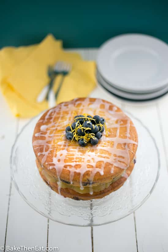Simple lemon blueberry cake ready to be sliced.
