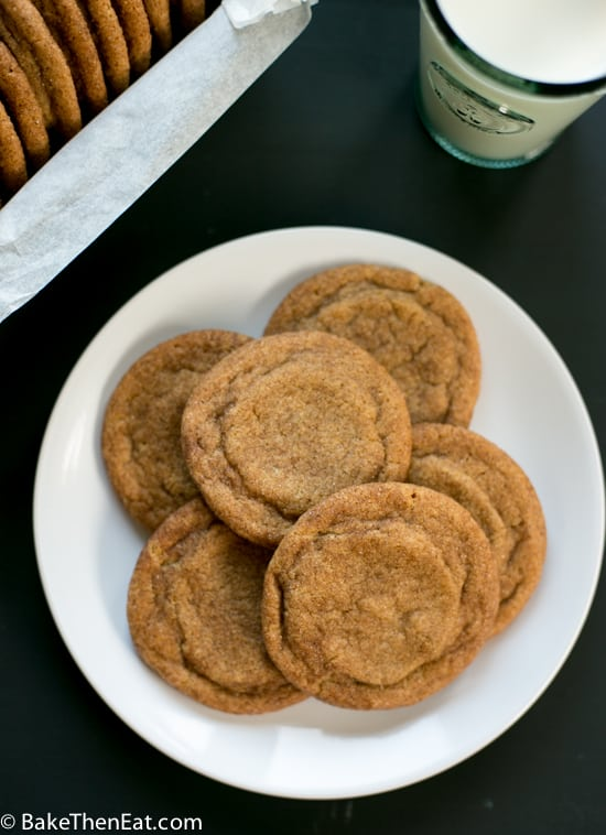 A big plate of cookies with a glass of milk