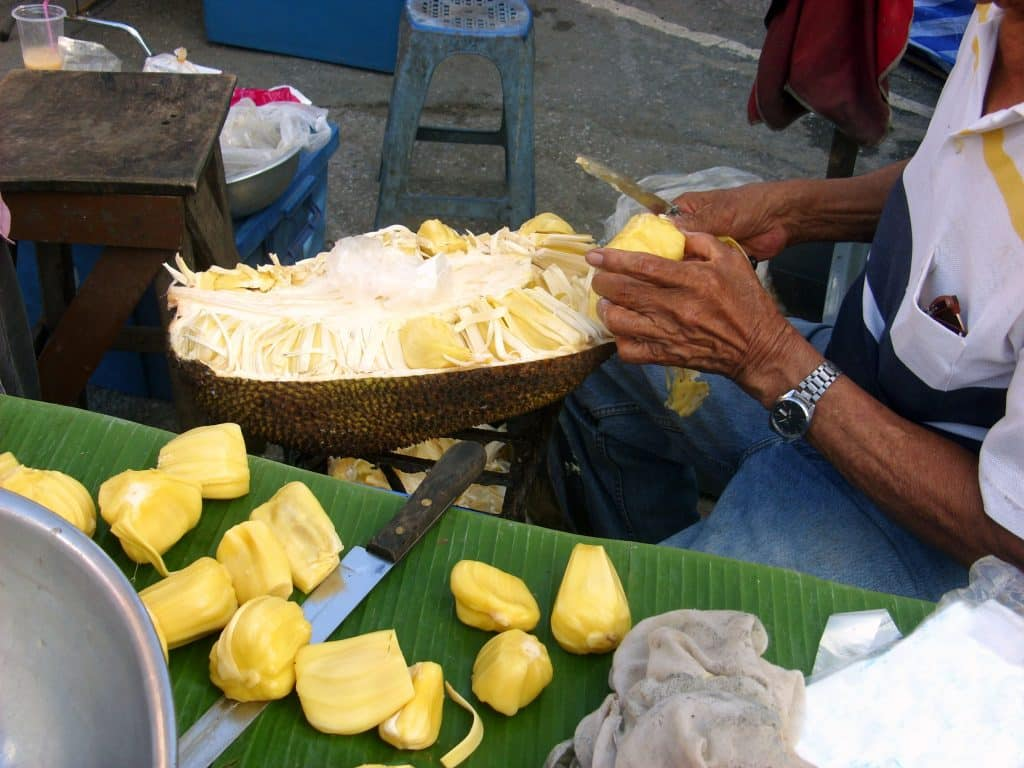 Jackfruit being sliced for the 2020 food trends predictions