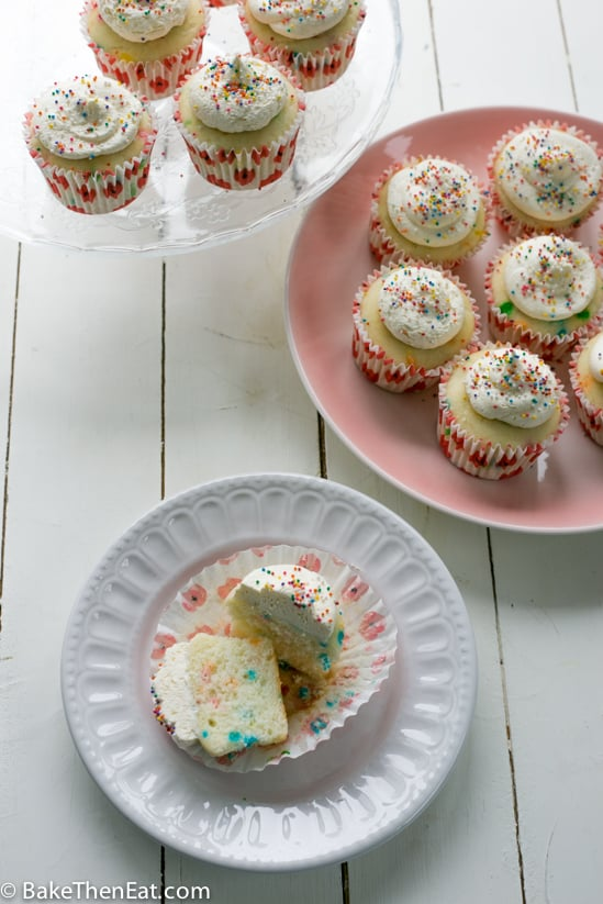 Lots of funfetti cupcakes and one sliced in two to see the inside of it.